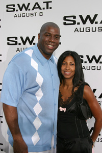 """""""S.W.A.T."""" Premiere 7-30-03Earvin """"Magic"""" Johnson and wifePhoto By Sam Kweskin - Image 21354_0062"""