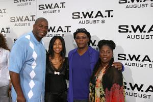 """S.W.A.T."" Premiere 7-30-03Earvin ""Majic Johnson, wife, Samuel L. Jackson, wifePhoto By Sam Kweskin - Image 21354_0065"