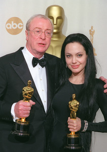 """72nd Annual Academy Awards "" 03/26/00 Michael Caine & Angelina Jolie © 2000 AMPAS/MPTV - Image 21723_0006"