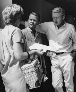 Dick Clark talking to secretary and actor Rod McKuen at rehearsalscirca 1966Photo by Joe Shere - Image 2196_0035