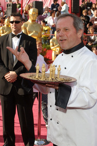 Celebrity chef Wolfgang Puck poses on the red carpet at the 77th Annual Academy Awards at the Kodak Theatre in Hollywood, CA on Sunday, February 27, 2005.  HO/AMPAS - Image 22270_0013