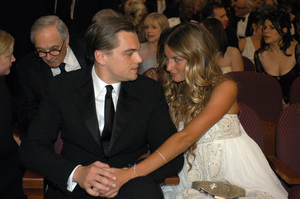 Academy Award Best Actor nominee Leonardo DiCaprio shares a moment with Gisele Bundchen during the 77th Annual Academy Awards at the Kodak Theatre in Hollywood, CA on Sunday, February 27, 2005.  HO/AMPAS - Image 22270_0150