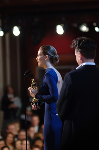 With Academy Award winner Sean Penn looking on, Hilary Swank accepts the Academy Award for Best Actress during the 77th Annual Academy Awards at the Kodak Theatre in Hollywood, CA on Sunday, February 27, 2005.  HO/AMPAS - Image 22270_0162