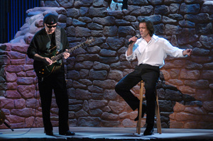 """Carlos Santana and Antonio Banderas perform """"Al Otro Lado Del Rio,"""" which was nominated for the Academy Award for Best Original Song, during the 77th Annual Academy Awards at the Kodak Theatre in Hollywood, CA on Sunday, February 27, 2005.  HO/AMPAS - Image 22270_0196"""
