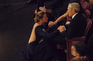 Hilary Swank shares a moment with Clint Eastwood, Oscar winner and Academy Award nominee for Best Director and Best Actor, after she was named the Academy Award winner for Best Actress during the 77th Annual Academy Awards at the Kodak Theatre in Hollywood, CA on Sunday, February 27, 2005.  HO/AMPAS - Image 22270_0232