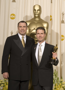 """The 78th Annual Academy Awards"" (Press Room)John Travolta, Dion Beebe03-05-2006 / Kodak Theatre / Hollywood, CA © 2006 AMPAS - Image 22701_0041"