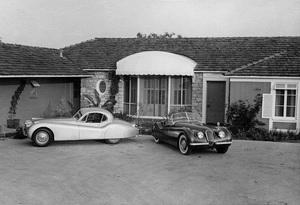 CarsJaguar 1951 XK 120s in front of Charles Hornburg