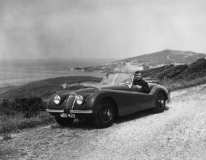 Clark Gable in his 1950 Jaguar XK 120 on the California coast1950** H.C. - Image 22813_0021