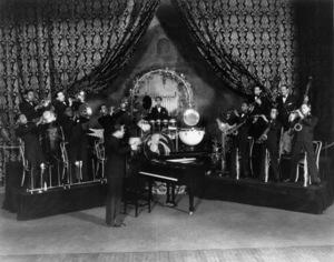 "Edward Kennedy ""Duke"" Ellington (orchestra) at the Fulton Theatre (Joe Nanton, Juan Tizol (trombones), Freddie Jenkins, Cootie Williams, Arthur Whetsol (trumpets), Sonny Greer (drums), Fred Guy (banjo), Wellman Braud (bass), Harry Carney, Johnny Hodges, Barney Bigard (reeds))1930** I.V.M. - Image 2326_0138"