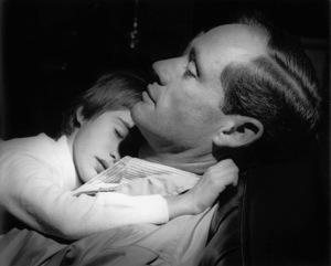 Mel Ferrer with sleeping child1957Copyright John Swope Trust / MPTV - Image 2348_0001