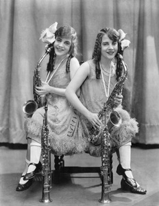 Violet and Daisy Hilton in vaudeville with saxophones1926** I.V. - Image 23543_0002