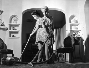 Violet and Daisy Hilton vacuum cleaning their home 1945** I.V. - Image 23543_0008