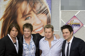 """Hannah Montana: The Movie"" (Premiere)Billy Ray Cyrus and Rascal Flatts (Jay DeMarcus, Gary LeVox, JoeDon Rooney)04-02-2009 / El Capitan Theatre / Hollywood, CA / Walt Disney Pictures / Photo by Benny Haddad - Image 23710_0063"