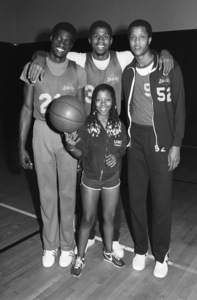 Patrice Rushen with Michael Cooper, Magic Johnson and Jamaal Wilkes of the Lakerscirca 1980© 1980 Bobby Holland - Image 23854_0018
