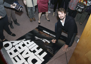 """Writer Mark Boal signs a """"Zero Dark Thirty"""" poster for a fan at the Writers Guild of America West """"Beyond Words 2013"""" screenwriter panel 02-07-2013© 2013 Michael Jones - Image 24263_0001"""