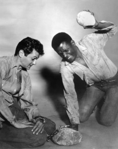 """Tony Curtis and Sidney Poitier during the making of """"The Defiant Ones""""1958 MGM** I.V. - Image 24287_0124"""