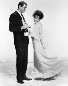 """Rock Hudson poses with a bottle of champagne and Leslie Caron in """"A Very Special Favor"""" 1965 Universal ** I.V. - Image 24287_0328"""