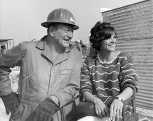 "John Wayne and Katharine Ross in ""Hellfighters""1968 Universal** B.D.M. - Image 24293_0360"