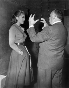 "Kim Novak and Alfred Hitchcock on the set of ""Vertigo""1958 Paramount** B.D.M. - Image 24293_0575"