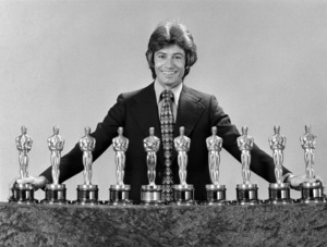 "George Chakiris poses with the ten Oscars won by the film ""West Side Story"" to promote the upcoming television debut of the film on NBCFebruary 1972 ** B.D.M. - Image 24293_0576"