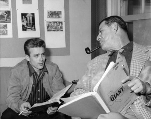 "James Dean and screenwriter Fred Guiol during filming of ""Giant""1955 Warner Bros.Photo by Floyd McCarty** B.D.M. - Image 24293_0611"