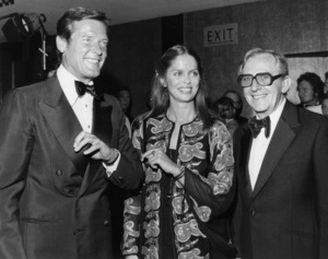 """Roger Moore, Barbara Bach and director Lewis Gilbert at the London premiere of """"The Spy Who Loved Me,"""" held at the Odeon Theatre, Leicester SquareJuly 7, 1977** B.D.M. - Image 24293_0644"""