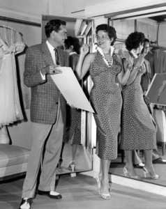 """Bill Thomas and Jane Russell discuss costume designs for """"Foxfire""""1955 Universal** B.D.M. - Image 24293_0707"""
