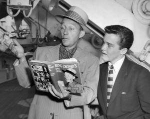Bing Crosby and youngest son, Lindsay, await the liner Liberte to dock in New York July 6, 1953** B.D.M. - Image 24293_0835