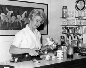 Doris Day makes a banana split at the bar in the living room of her Beverly Hills home1959** B.D.M. - Image 24293_0842