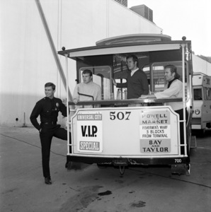 """Kent McCord greets unidentified sports personalities during the filming of """"Adam-12""""circa 1969** B.D.M. - Image 24293_0887"""