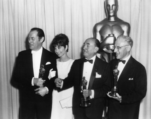 """Rex Harrison, Audrey Hepburn, Jack L. Warner and George Cukor at """"The 37th Annual Academy Awards""""April 5, 1965** B.D.M. - Image 24293_0973"""