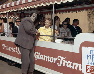 """Pat Nixon with the Frankenstein monster while she rides on a """"Glam Tram"""" at Universal Studios Tourcirca 1969** B.D.M. - Image 24293_0977"""