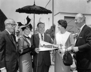 "Edmond L. DePatie (Warner Bros. Vice President), Natalie Wood, Sam Yorty (Mayor of Los Angeles), Baronne de Cabrol and Baron Louis de Cabrol (French Consul General) attend a special race on the Warner Bros. lot to commence the start of filming on ""The Great Race""1965 Warner Bros.** B.D.M. - Image 24293_1105"