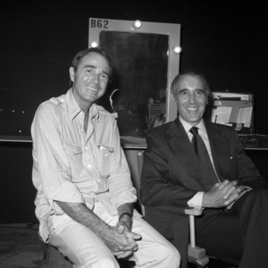 """Army Archerd and Christopher Lee on the set of """"Airport"""