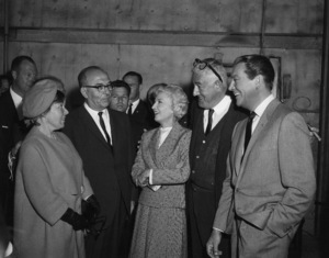 """Barbara Stanwyck, William Castle and Robert Taylor greet Levi Eshkol, the Prime Minister of Israel, and his wife Miriam on the set of """"The Night Walker"""" 1964 Universal ** B.D.M. - Image 24293_1568"""