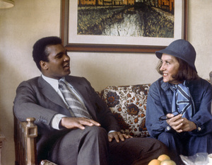 """Muhammad Ali and Gloria Swanson in the green room of the Dulles International Airport (The two appeared in a press conference together.  Swanson was filming """"Airport 1975"""" at the time) September 5, 1974 ** B.D.M. - Image 24293_1623"""