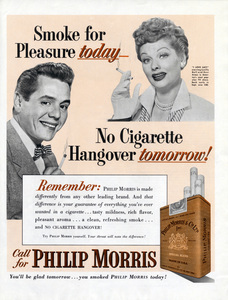 Desi Arnaz and Lucille Ball in a print ad for Philip Morris cigarettes1952** B.D.M. - Image 24293_2696