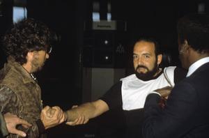 Bob Dylan assaults photographer Bob Scott at LAX AirportApril 3, 1983© 1983 Gary Lewis - Image 24300_0379