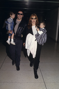 Bruce Springsteen with his wife, Patti Scialfa, and their children, Evan and Jessecirca 1990s© 1990 Gary Lewis - Image 24300_0549