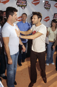 Simon Cowell and Ryan Seacrest during Nickelodeon