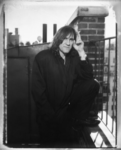 Gerard Depardieu photographed on the roof his hotel in New York City1990© 1990 Ken Shung - Image 24302_0013