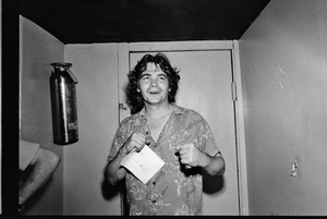 John Prine photographed in the dressing room of a Long Island club named