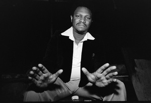 McCoy Tyner photographed in the dressing room of a Long Island club named