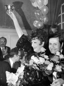 Lucille Ball is awarded a cup given to her at the Colony Restaurant in New York as