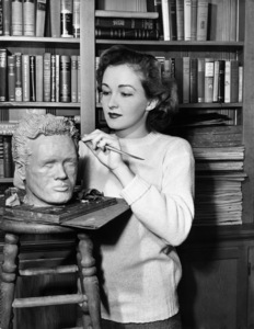 """Nina Foch works on a head of Dick Dickerson during the making of """"My Name Is Julia Ross"""" 1945 © 1978 Ned Scott Archive - Image 24327_0015"""