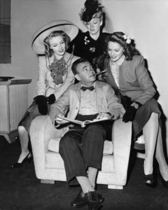 """Susann Shaw, director Charles Vidor, Eve Arden and Jinx Falkenburg on the set of """"Cover Girl""""1944 Columbia Pictures© 1978 Ned Scott Archive - Image 24327_0074"""