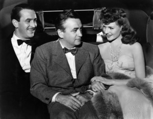 """Lee Bowman, director Charles Vidor and Rita Hayworth on the set of """"Cover Girl""""1944 Columbia Pictures© 1978 Ned Scott Archive - Image 24327_0076"""