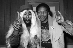 George Clinton of Parliament-Funkadelic and Music Journalist Steven Ivory hanging out backstage at The Philadelphia Spectrum, Philadelphia PA1978© 1978 Bobby Holland - Image 24331_0123