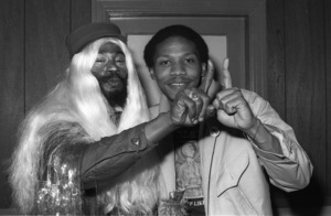 George Clinton of Parliament-Funkadelic and Music Journalist Steven Ivory hanging out backstage at The Philadelphia Spectrum, Philadelphia PA1978© 1978 Bobby Holland - Image 24331_0125