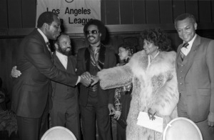 Vernon Jordon, Berry Gordy Jr., Stevie Wonder & guest with John Mack and his wife at the Urban League Awardscirca mid 1970s© 1978 Bobby Holland - Image 24331_0139